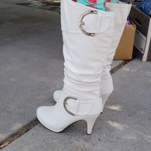 Knee high white leather heeled boots